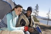 Happy young couple at campsite — Stock Photo
