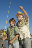 Boy and grandfather showing off fish — Stock Photo
