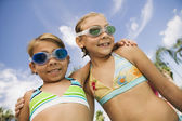 Two girls at the pool — Stock Photo