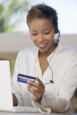 Woman Using Credit Card Online — Stock Photo