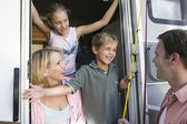 Family in camper van — Stock Photo