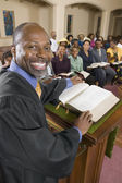 Preacher at altar — Stock Photo