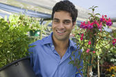 Man Carrying Plants — Stock Photo