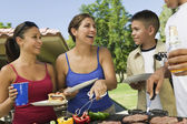 Family Gathered Around Grill — Stock Photo