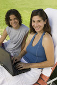 Mother Using Laptop Outdoors with son — Stock Photo