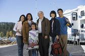 Family holding fishing poles — Stock Photo