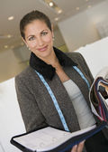 Saleswoman With Organizer and Swatches — Stock Photo