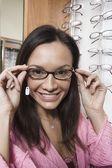 Woman trying on eyeglasses — Stock Photo