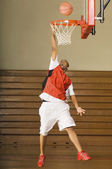 Basketball player missing slam dunk — Stock Photo