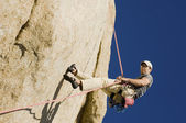 Man Rappelling from Cliff — Stock Photo