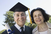 Senior graduate and wife — Stock Photo