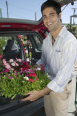 Man Loading Flowers into Van — Stock Photo