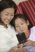 Mother and Daughter Playing Video Game — Stock Photo