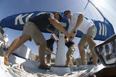 Sailors operating windlass on yacht — Stock Photo