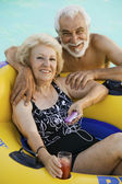 Senior Couple in Swimming Pool — Stock Photo