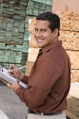 Supervisor stock taking in warehouse — Stock Photo
