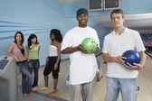 Men holding bowling balls — Stock Photo