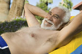Senior Man Lying on sunlounger — Stock Photo