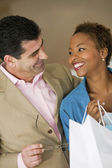 Happy Couple With Shopping Bag — Stockfoto