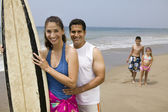 Family with Surfboard on Beach — Stock Photo