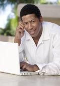 Man on patio Using Laptop — Stock Photo