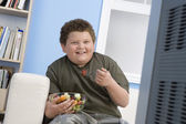Overweight boy eating fruits — Zdjęcie stockowe