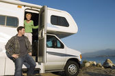 Couple in RV at lakeshore — Stock Photo
