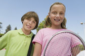Brother and Sister with Tennis Racket — Stock Photo