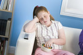 Overweight girl sleeping on sofa — Stock Photo