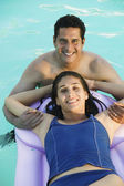 Couple in Swimming Pool — Stock Photo