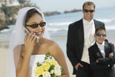 Bride using mobile phone — Stock Photo