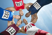 Athletes forming huddle — Stock Photo
