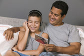 Father and Son listening to Music — Stock Photo
