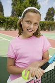 Young girl with tennis racket — Stock Photo