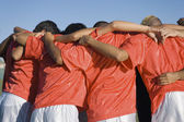 Soccer team in huddle — Stock Photo