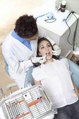 Dentist examining patient — Stock Photo