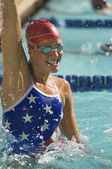 Female swimmer celebrating victory — Stock Photo