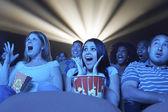 People watching horror movie in the theatre — Foto de Stock