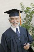 Senior graduate smiling — Stock Photo