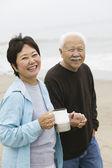 Loving mature couple at beach — Stock Photo