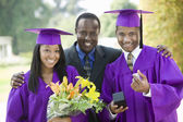 Father with Graduates — Stock Photo