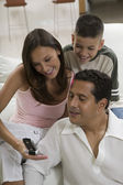 Family looking at picture — Stock Photo