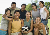 People in park holding soccer ball. — Stock Photo