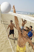 Man Blocking Volleyball at Net — Stock Photo