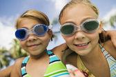 Girls wearing swim goggles — Stock Photo