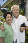 Senior couple with binoculars — Stock Photo