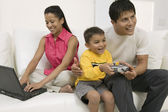 Father playing video game with son — Stock Photo