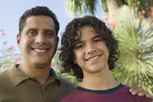 Father with Arm Around Son — Stock Photo