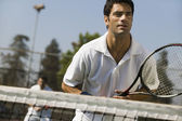 Male doubles tennis players — Stock Photo