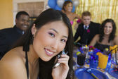 Teenage Girl at Party Using Cell Phone — Stock Photo